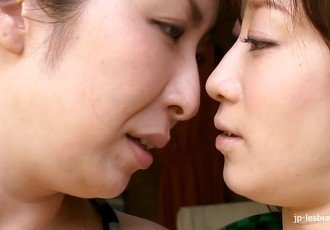 Hairy Japanese MILFs kissing and